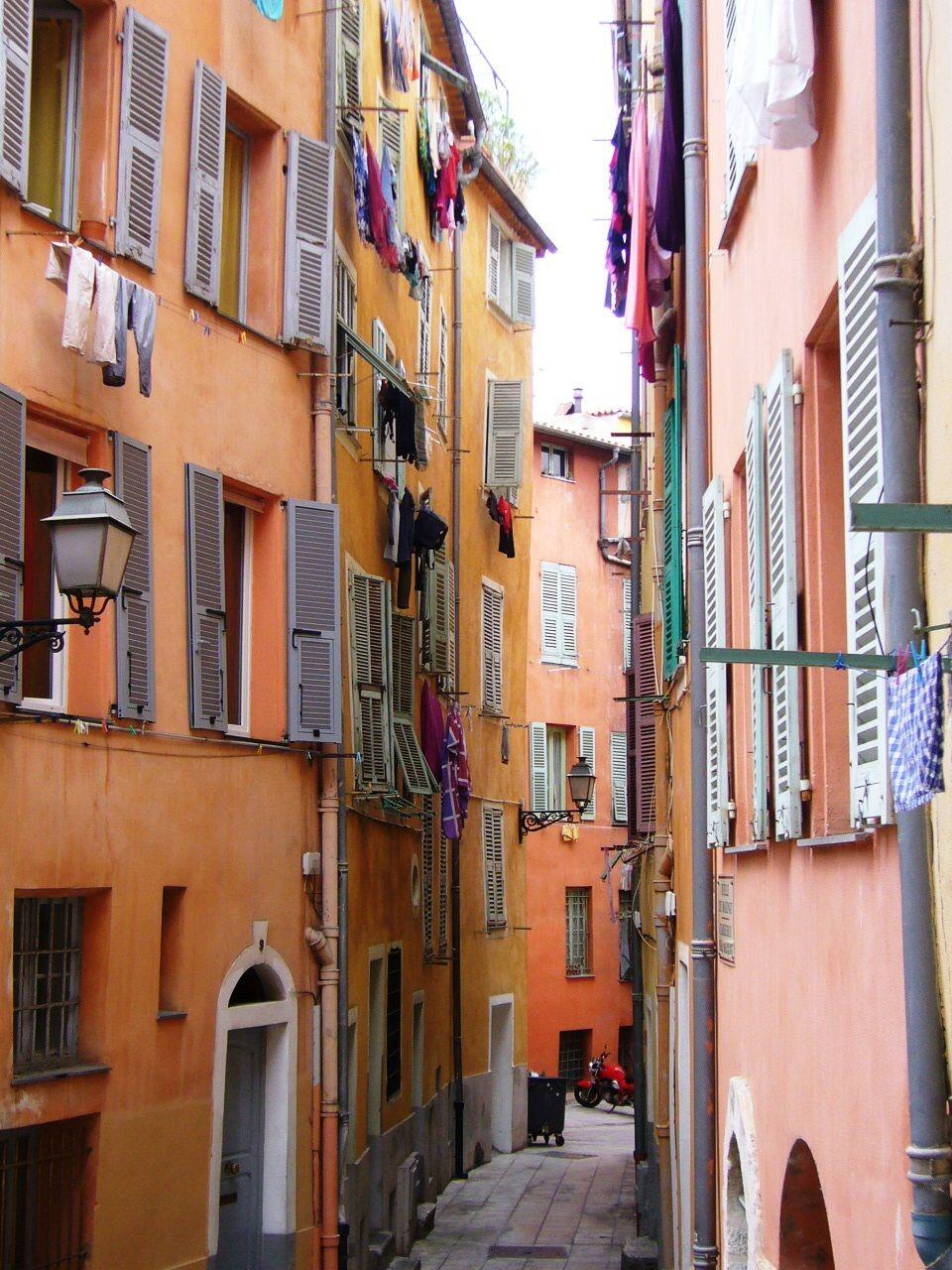 colourful streets of Old Nice St Honorat monastery with Cannes behind Fete des Mais, traditional Nicois costume @FibiTee