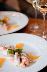 sole and salmon-tresse in orange butter sauce