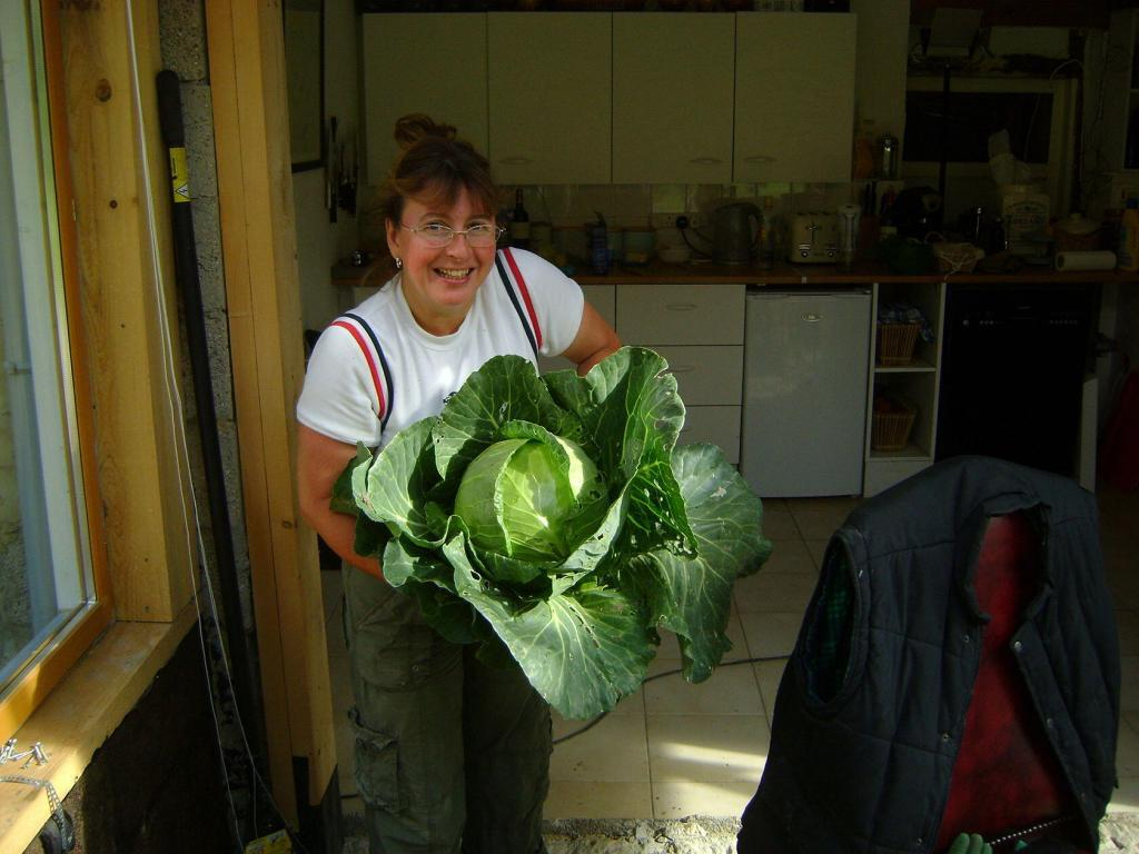 My Good Life France Janine Marsh with a cabbage from the garden
