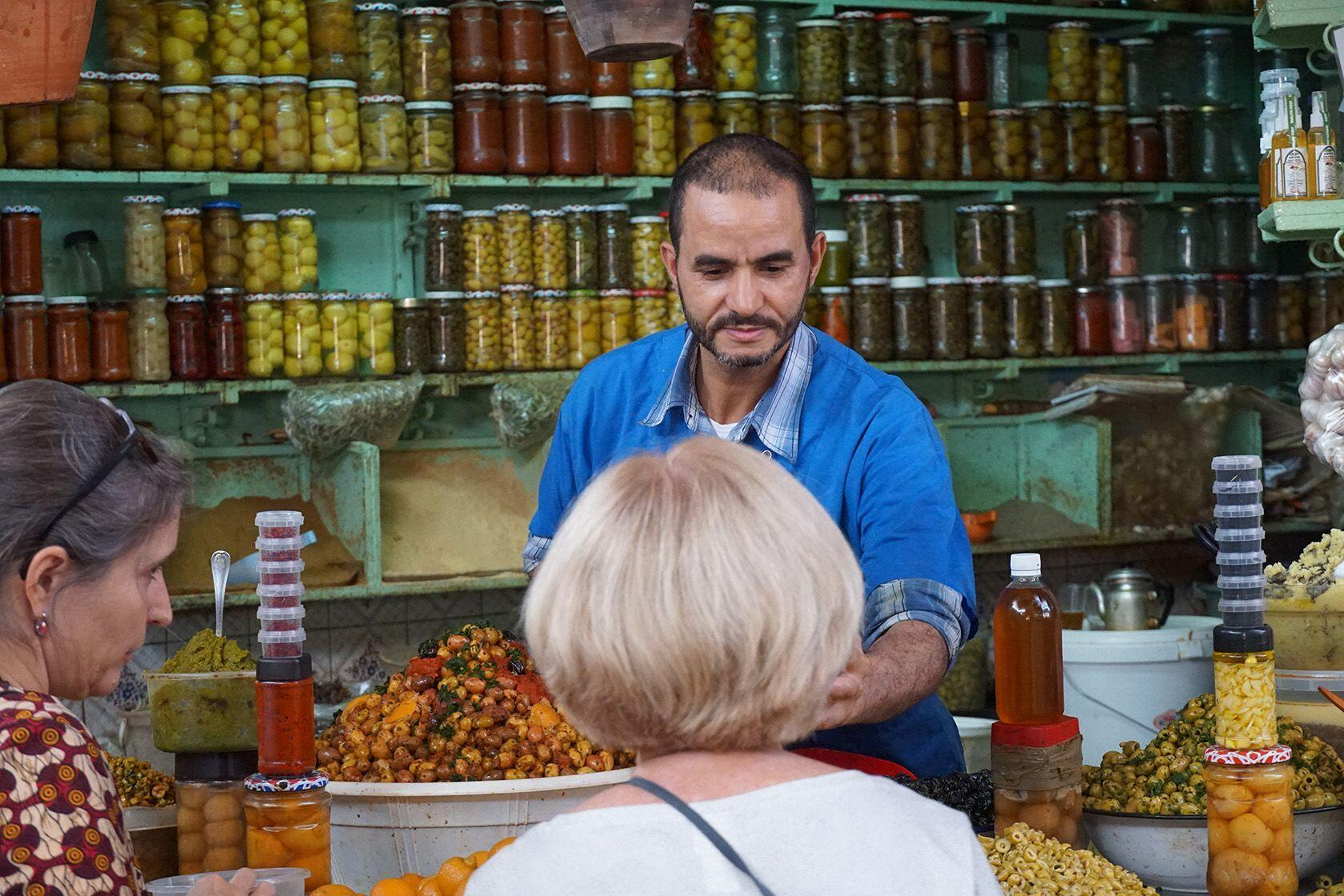 Marrakesh Olive Vendor Culinary Exploration Pitcher and Powell Adventures
