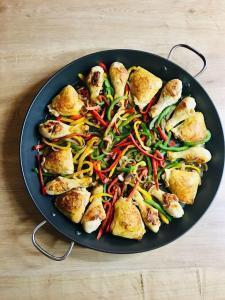 Spanish Paella Provence The pre-cooked chicken with fried peppers and onion