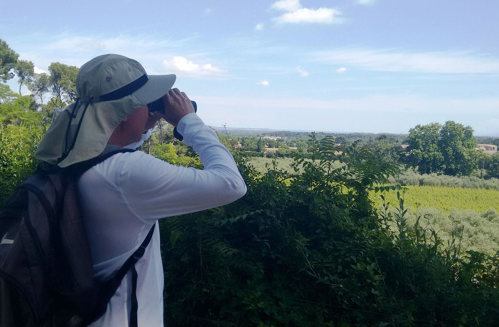 St Remy Provence Lifestyle A birder scans the sky from the Voie Domitia
